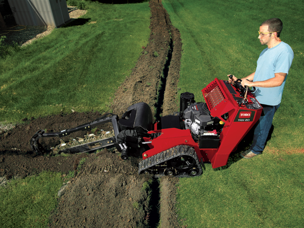 Trenching Machines Working : Hand vs machine digging a trench english content